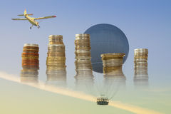 Gas Balloon, Stakes of Coins and Yellow Aircraft against the Sky Royalty Free Stock Photos