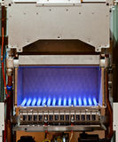 Gas boiler. Gas flame inside of the gas boiler stock photo