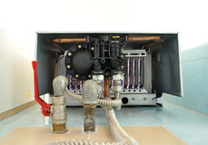 Gas boiler home maintenance. Gas boiler, home maintenance, power and energy Royalty Free Stock Images