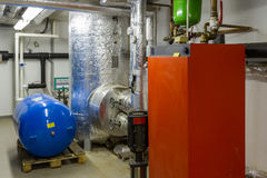 Gas boilers. In gas boiler room stock image