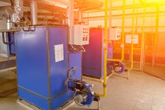Gas boilers for factory heating. Steamshop royalty free stock photography