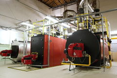 Gas boilers in gas boiler room Royalty Free Stock Image
