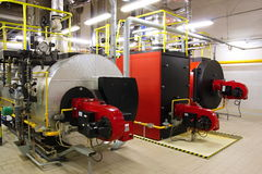 Gas boilers in gas boiler room Stock Image