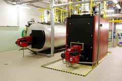 Gas boilers in gas boiler room. For steam production stock images