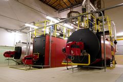 Gas boilers in gas boiler room. For steam production stock photo