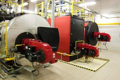 Gas boilers in gas boiler room. For steam production royalty free stock photography
