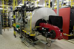 Gas boilers in gas boiler room. For steam production stock image