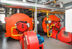 Gas boilers in gas boiler room for steam production Stock Image
