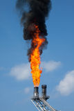 Gas burn or Flare burn in offshore location, Oil and gas process Royalty Free Stock Images
