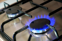 Gas burner. Fire burning blue on the kitchen gas burner royalty free stock photo