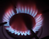 The gas burner. Gas burner on a black stock photos