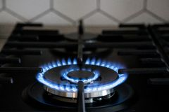 Gas burner on black modern kitchen stove. kitchen gas cooker with burning fire propane gas.  royalty free stock image