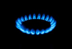 Gas burner blue close up. Gas burners in the kitchen oven Royalty Free Stock Photo