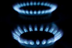 Gas burner with fire on black background Stock Images