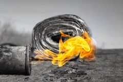 Gas burner with fire and roll of roofing material on blurred background with bokeh effect royalty free stock images