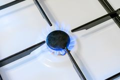 Gas burner flame close up. Can be a source of fire or explosion. Household gas stove stock photos