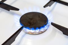 Gas burner flame close up. Possible leakage and gas poisoning. Household gas stove stock photography