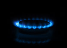 Gas burner with flames on dark background Stock Image
