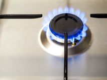 Gas burner ignited. Gas burner ignition on a stainless steel surface Stock Photography
