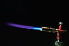 Gas burner. Instrument gas burner flame burns blue machine royalty free stock photos