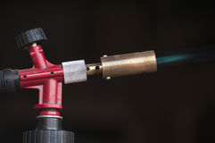 Gas burner. Instrument gas burner flame burns blue machine stock photo