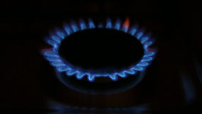 Gas burner on-off. A gas stove with blue flames in the dark, and turning on and off stock video