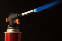 Gas burner - the tool is lit a blue flame Royalty Free Stock Photography