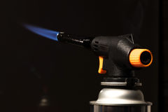 Gas burner - the tool is lit a blue flame Royalty Free Stock Photo