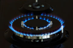 Gas burners lit. Gas burner is lit on the kitchen Stock Photos