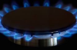 Gas burners lit. Gas burner is lit on the kitchen Stock Images