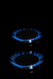 Gas burners lit. Gas burner is lit on the kitchen Stock Image