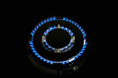 Gas burners lit. Gas burner is lit on the kitchen Royalty Free Stock Photo