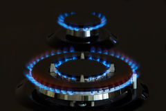 Gas burners lit. Gas burner is lit on the kitchen Stock Photo