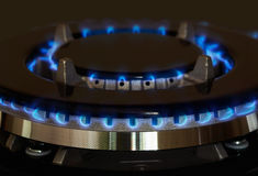 Gas burners lit. Gas burner is lit on the kitchen Royalty Free Stock Image