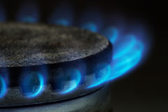 Gas burning. By a dark blue flame on modern kitchen Royalty Free Stock Photography
