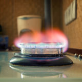 Gas burning blue flame Stock Photos