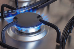 Gas burning on the kitchen gas stove Stock Photo