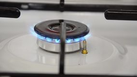 Gas burning from a kitchen gas stove stock video footage