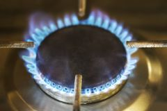 Gas burning from a kitchen stove. Burning gas on the old kitchen gas stove stock photography