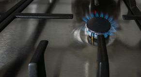 Gas burns in the kitchen on the gas stove stock image