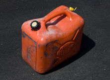 Gas can. Orange gas can on pavement royalty free stock image