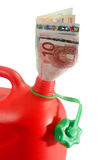 Gas can. Red gas can with banknotes isolated on white background royalty free stock photo