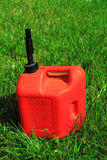 Gas Can. Five gallon non-spill plastic red gas can on green lawn stock images