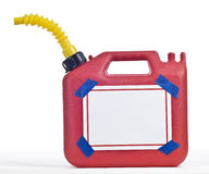 Gas Can With Sign and Blue Tape. A red fuel can with a yellow spout with a blank sign held on by blue tape on a white background stock photography
