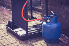 Gas canister and portable barbecue Stock Images
