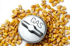 Gas cap with corn used for ethanol. Metal gas cap shot with corn kernals used for ethanol, on white background with soft shadows Stock Photo