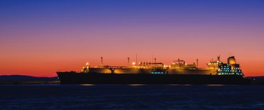 GAS CARRIER. Tanker at the wharf in the harbor at dawn Royalty Free Stock Images