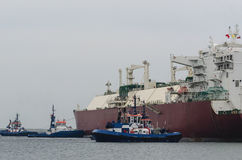 GAS CARRIER AND TUGS IN SWINOUJSCIE Royalty Free Stock Photo
