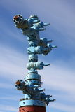 Gas chink. Blue installation on a gas chink with the established latches against the sky Stock Images