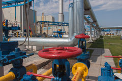 Red handle gate valve with steel pipe on gas compressor station Stock Image
